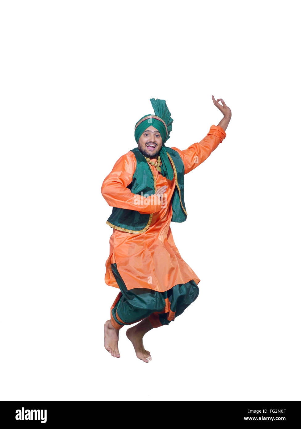 Dancer performing folk dance bhangra MR#779F - Stock Image