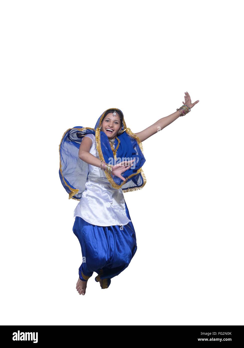 Dancer performing folk dance bhangra MR#779D - Stock Image