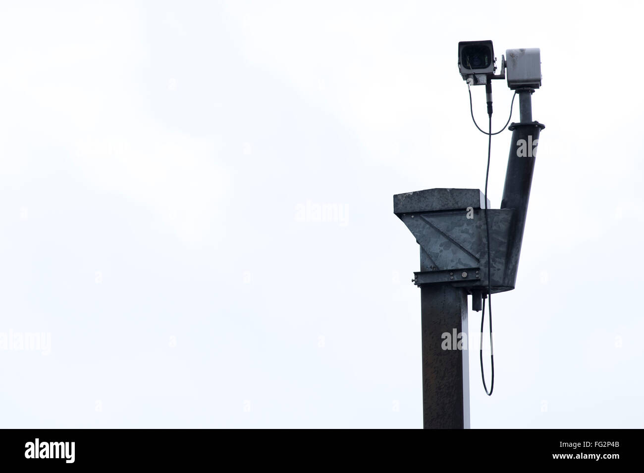 CCTV security camera against a plain background. - Stock Image