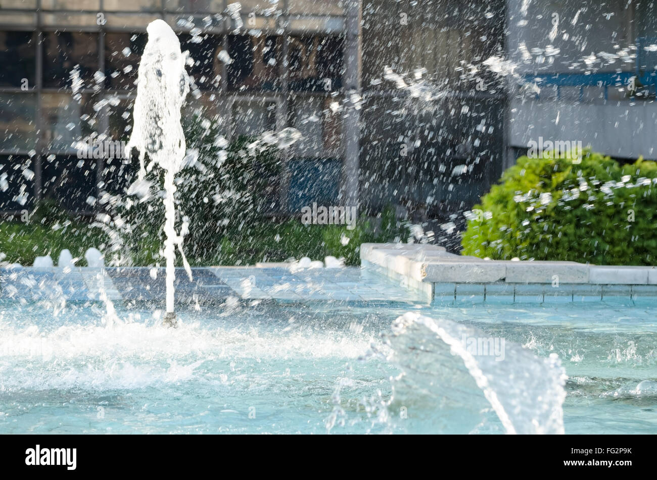 Splashing Water in City Fountain in the Summer Daytime - Stock Image