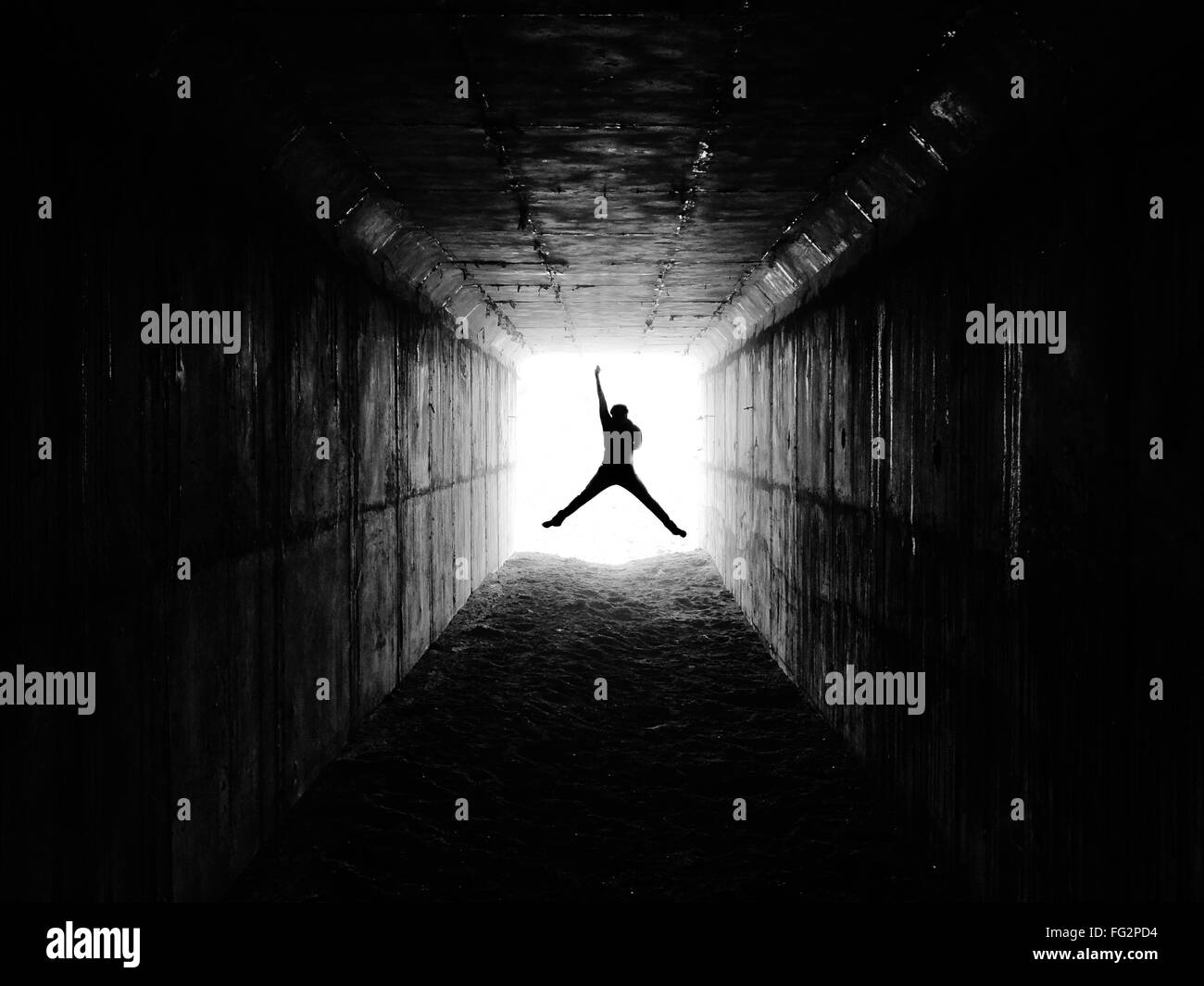 View Of Man Jumping In Excitement In Tunnel - Stock Image