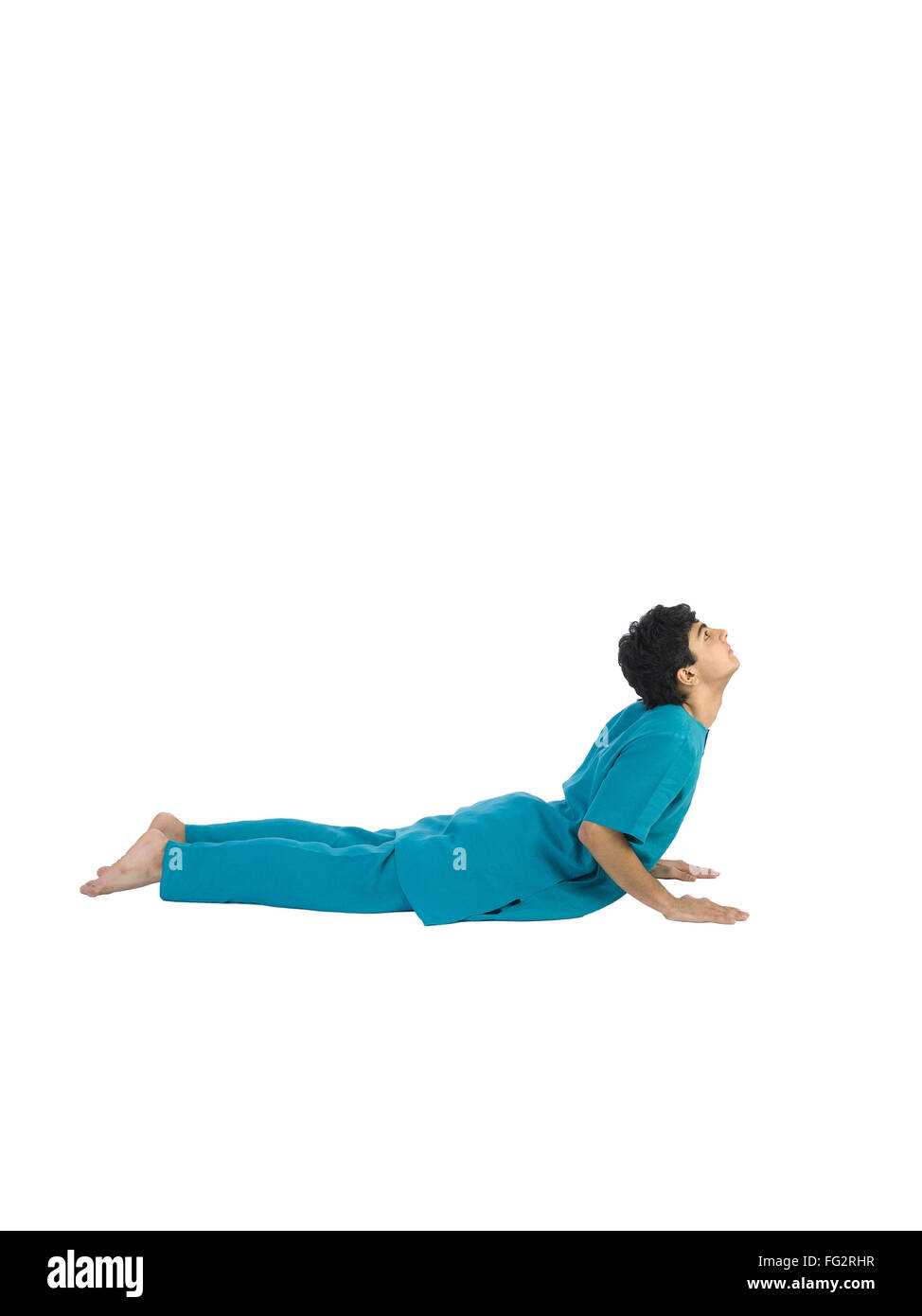 Boy practicing asana MR#779I - Stock Image