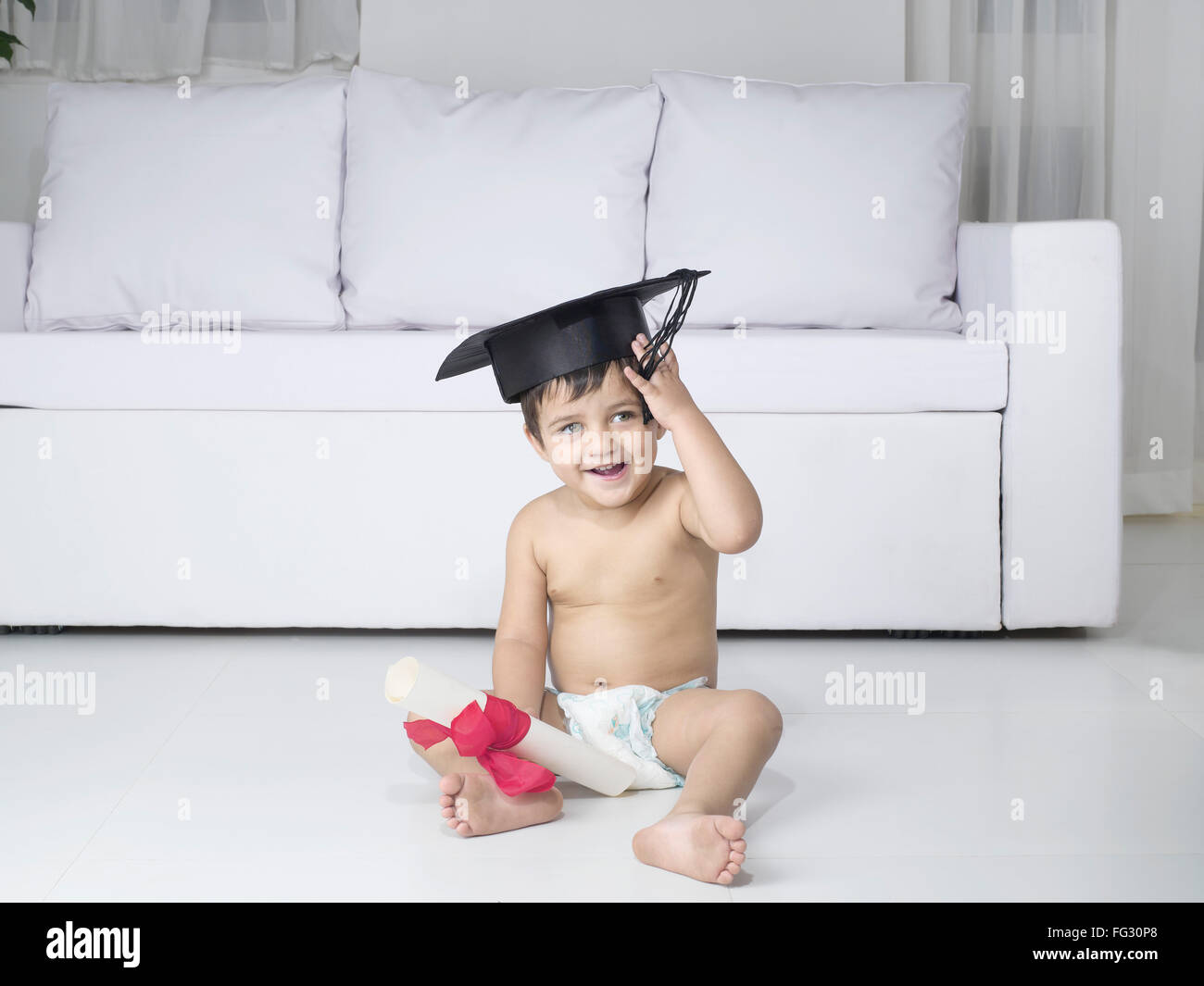 Baby holding degree certificate ; MR#779O - Stock Image