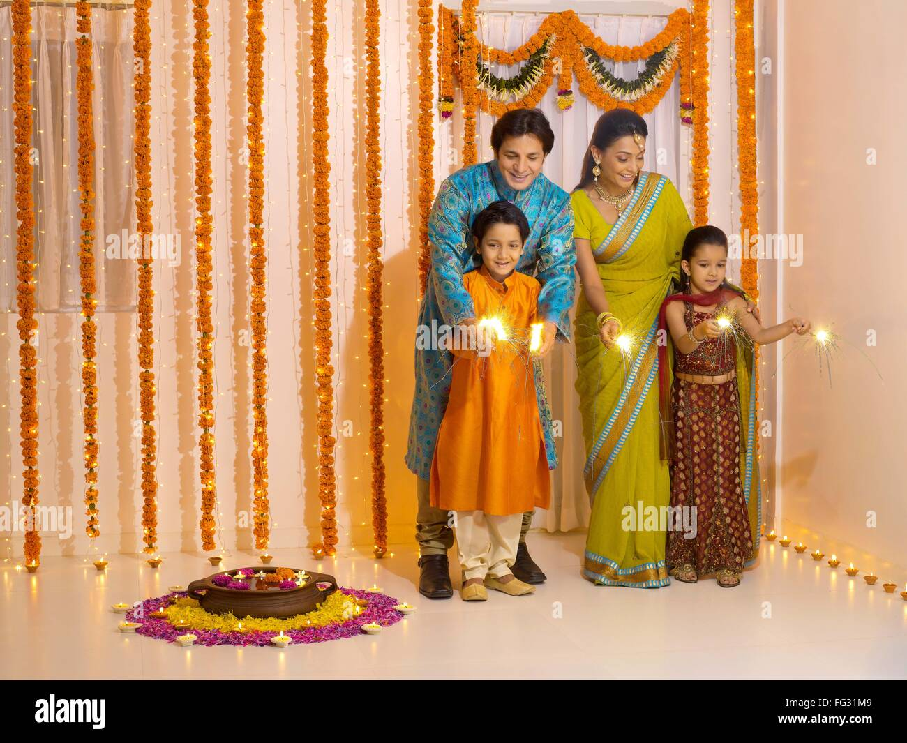 Indian family celebrating Diwali festival of lights India - model released MR#779P, MR#779Q, MR#779R, MR#779S - Stock Image