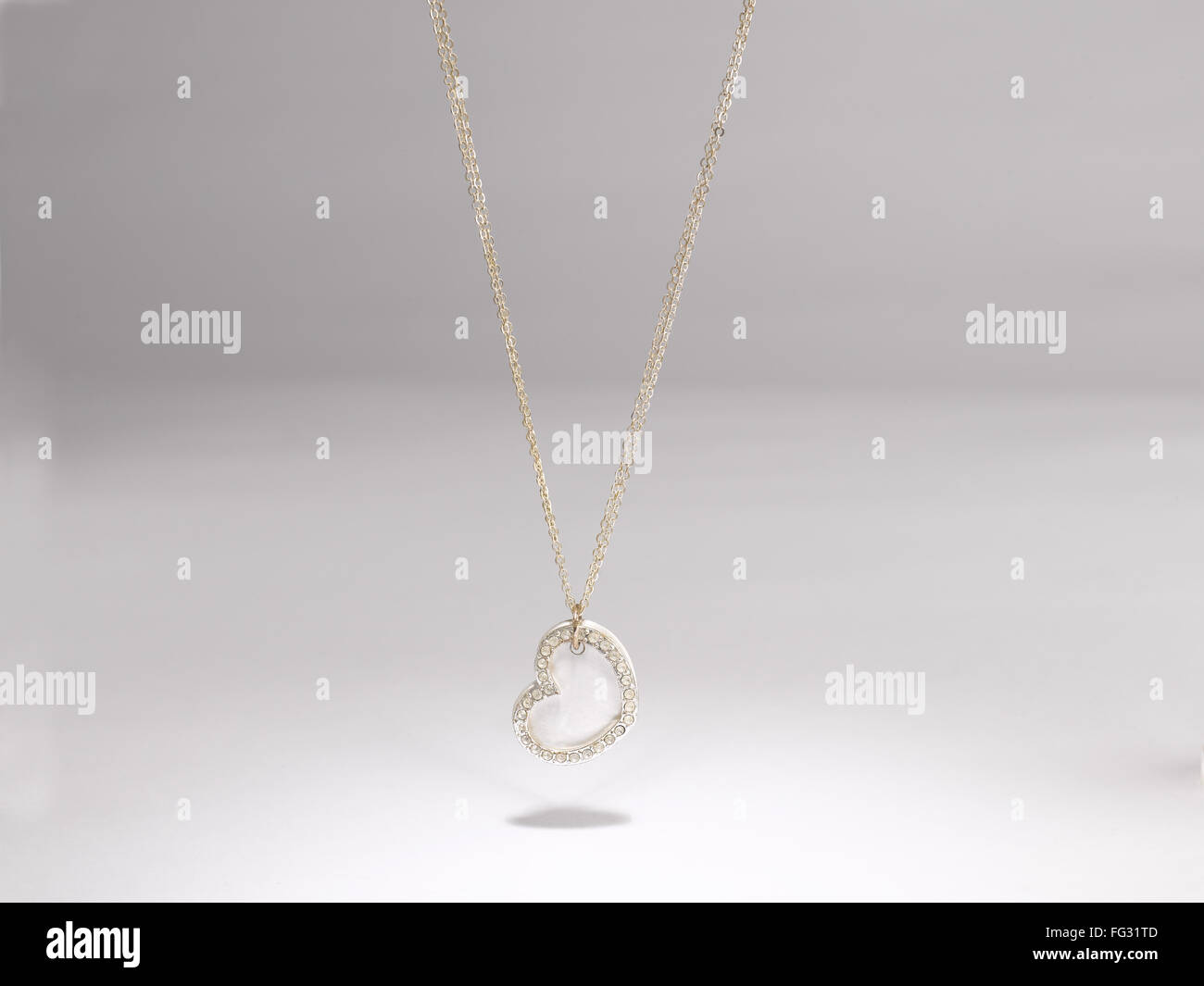 heart shaped pendant imitation silver jewellery - Stock Image