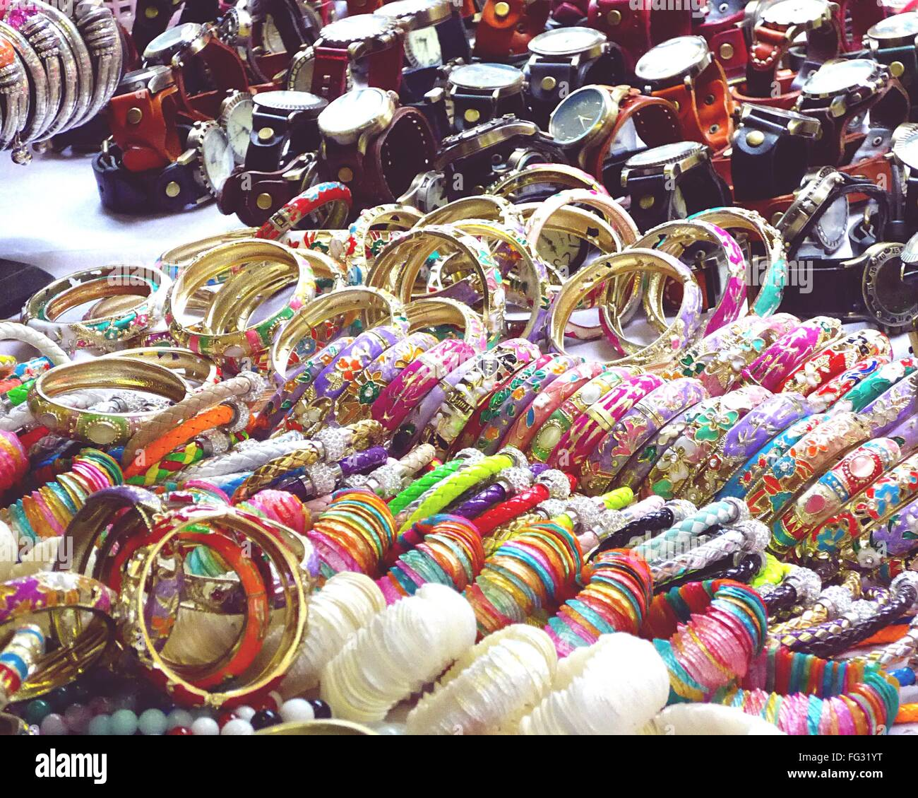 Colorful Bangles And Wristwatches For Sale At Market - Stock Image