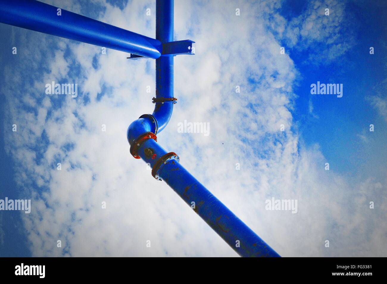 Low Angle View Of Blue Pipe Against Sky - Stock Image