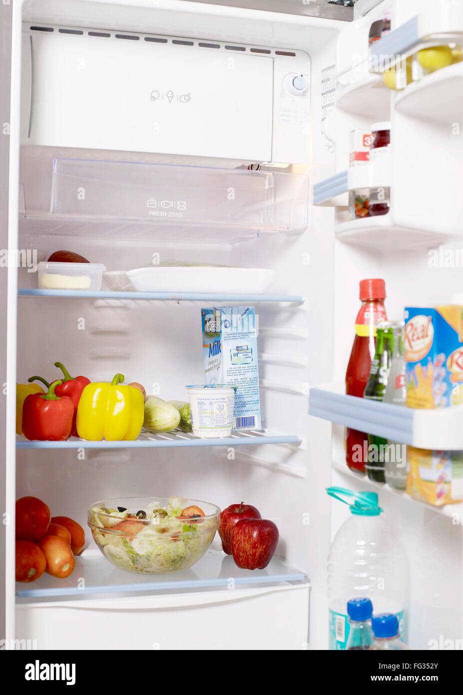 Various food ingredients and drinks kept in refrigerator - Stock Image