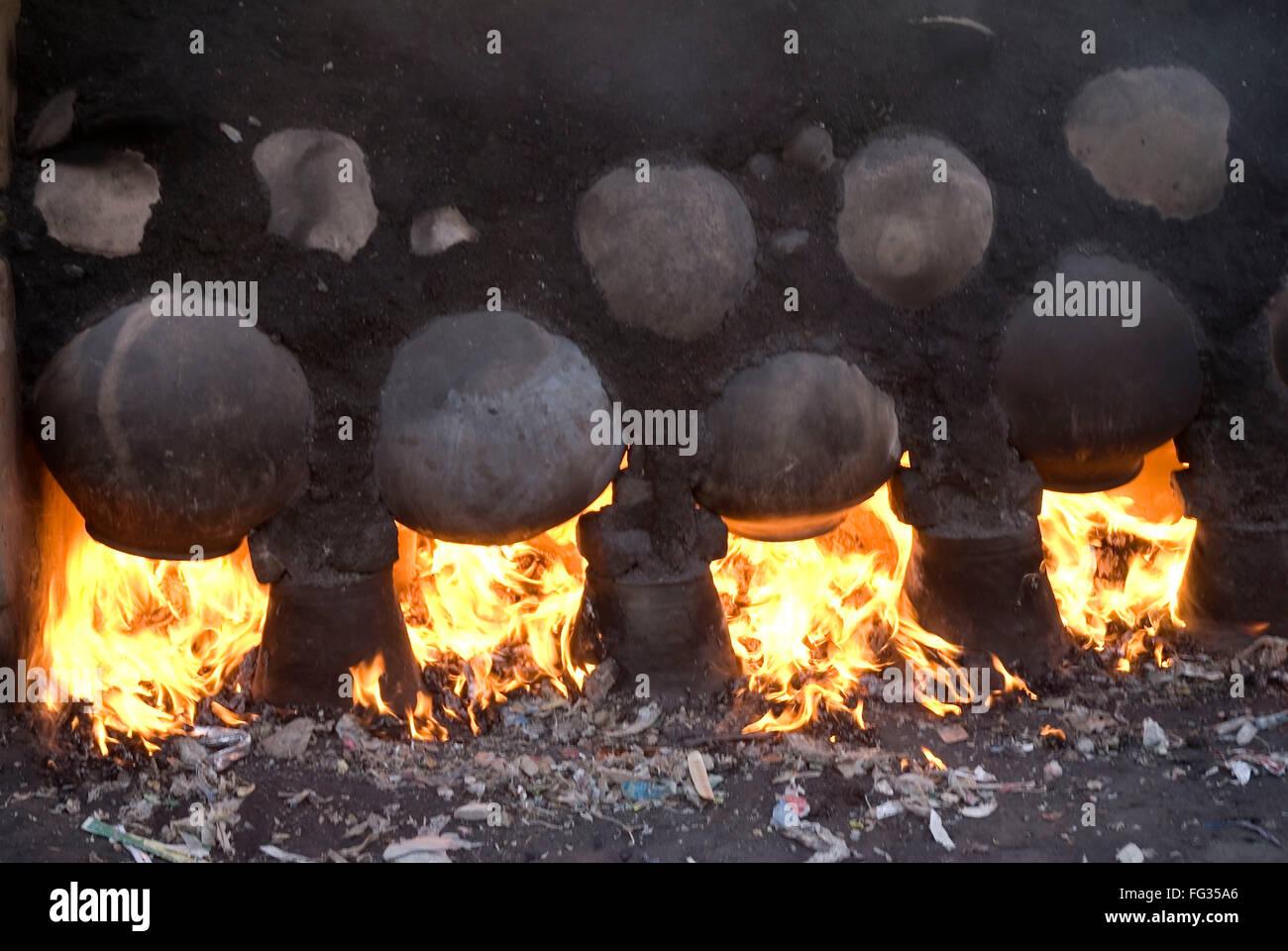 Earthenware baking , Padhegaon , District Ahmednagar , Maharashtra , India - Stock Image