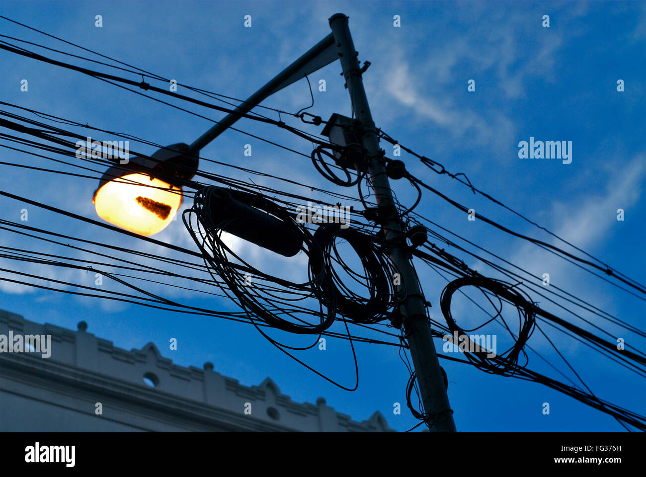 Cluster Of Wires Tied To Glowing Street Lamppost Stock Photo Wiring A Lamp Post