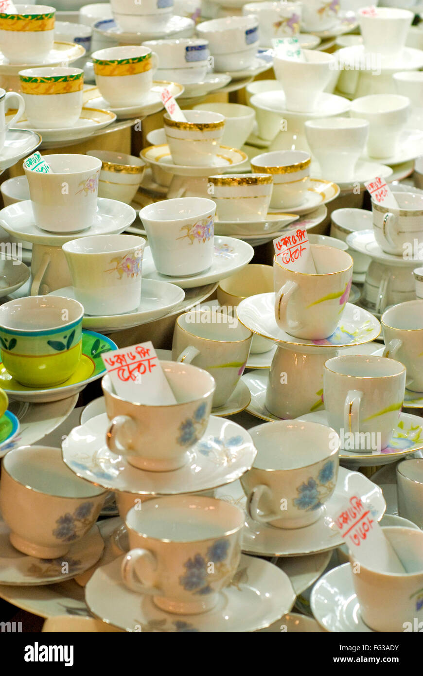 Empty tea cups and saucers for sale in New Market ; Dhaka ; Bangladesh - Stock Image
