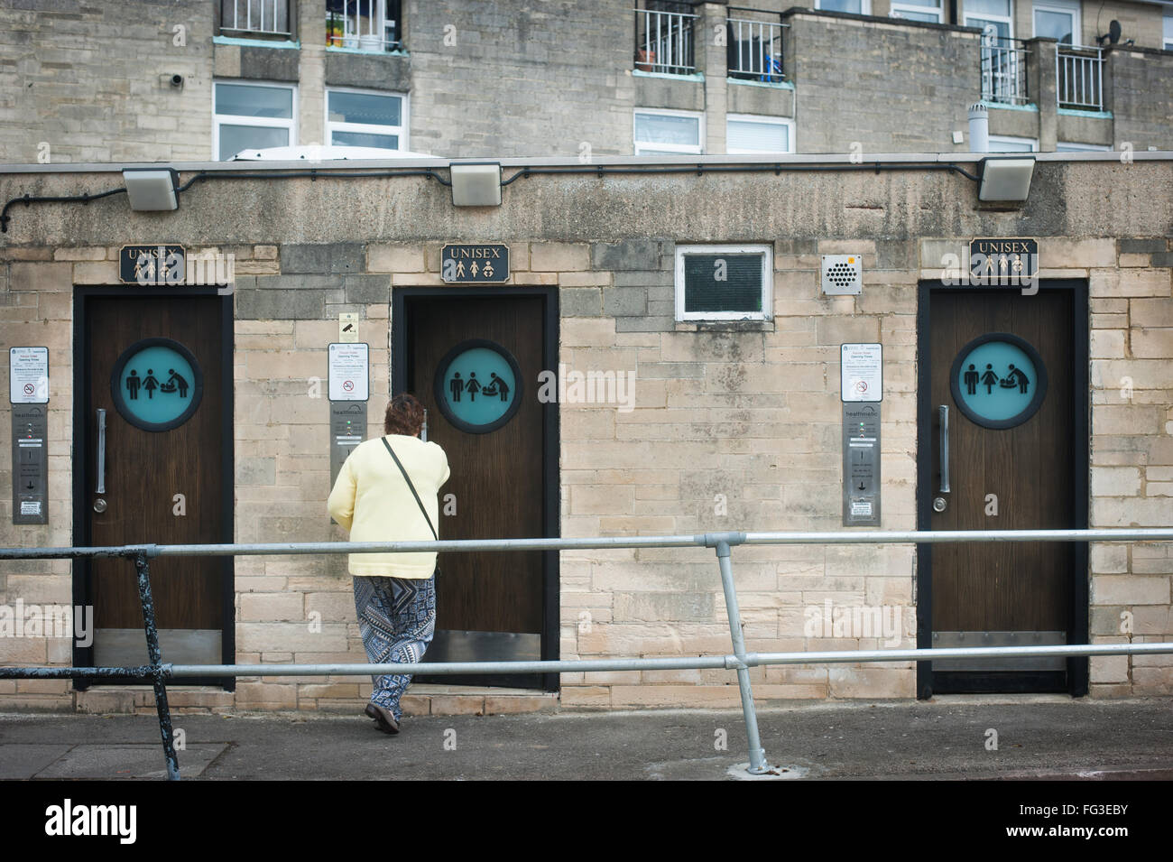 Woman about to use public toilets in Cirencester, Cotswolds - Stock Image
