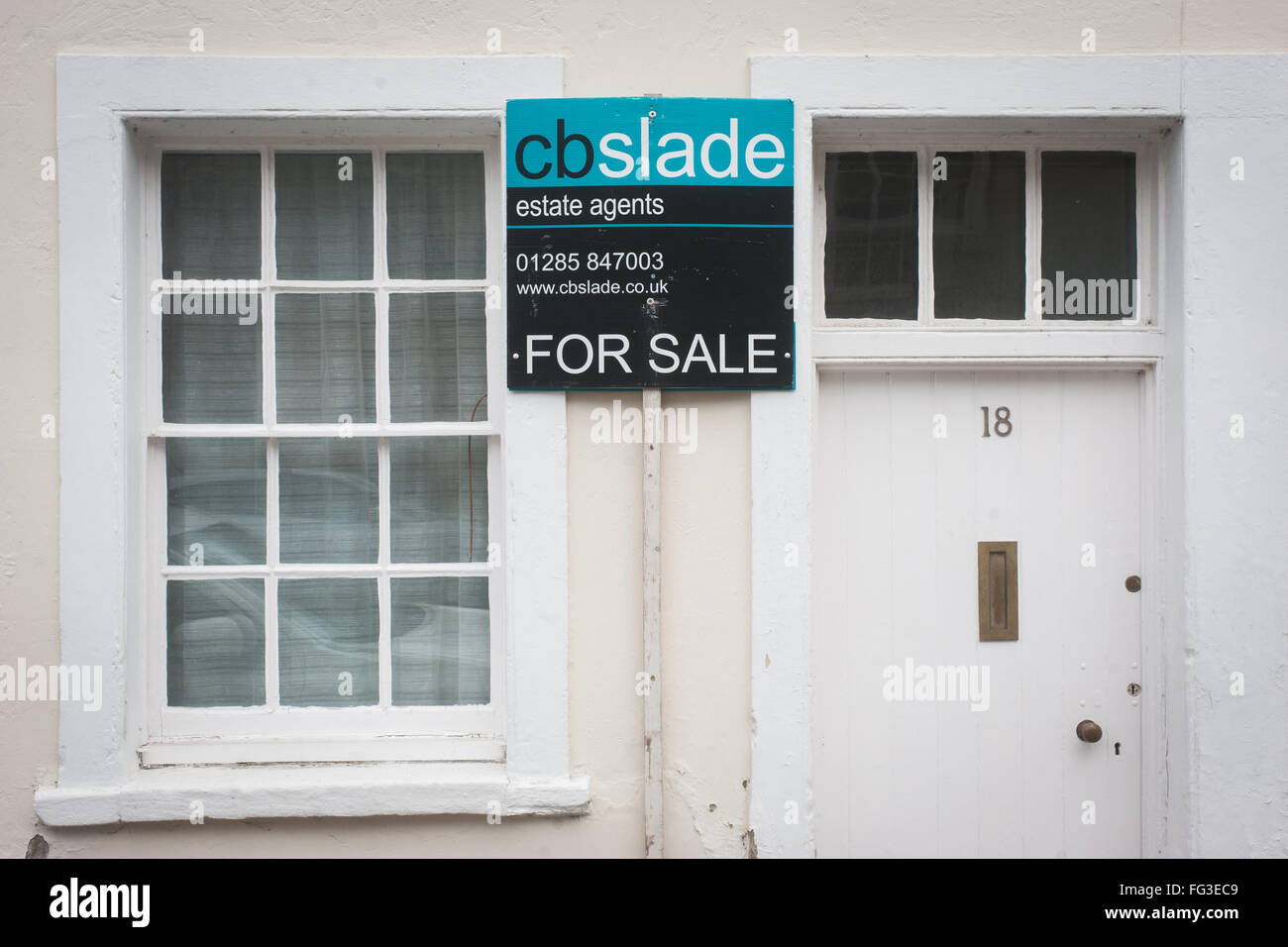 House for Sale with estate agents board - Stock Image