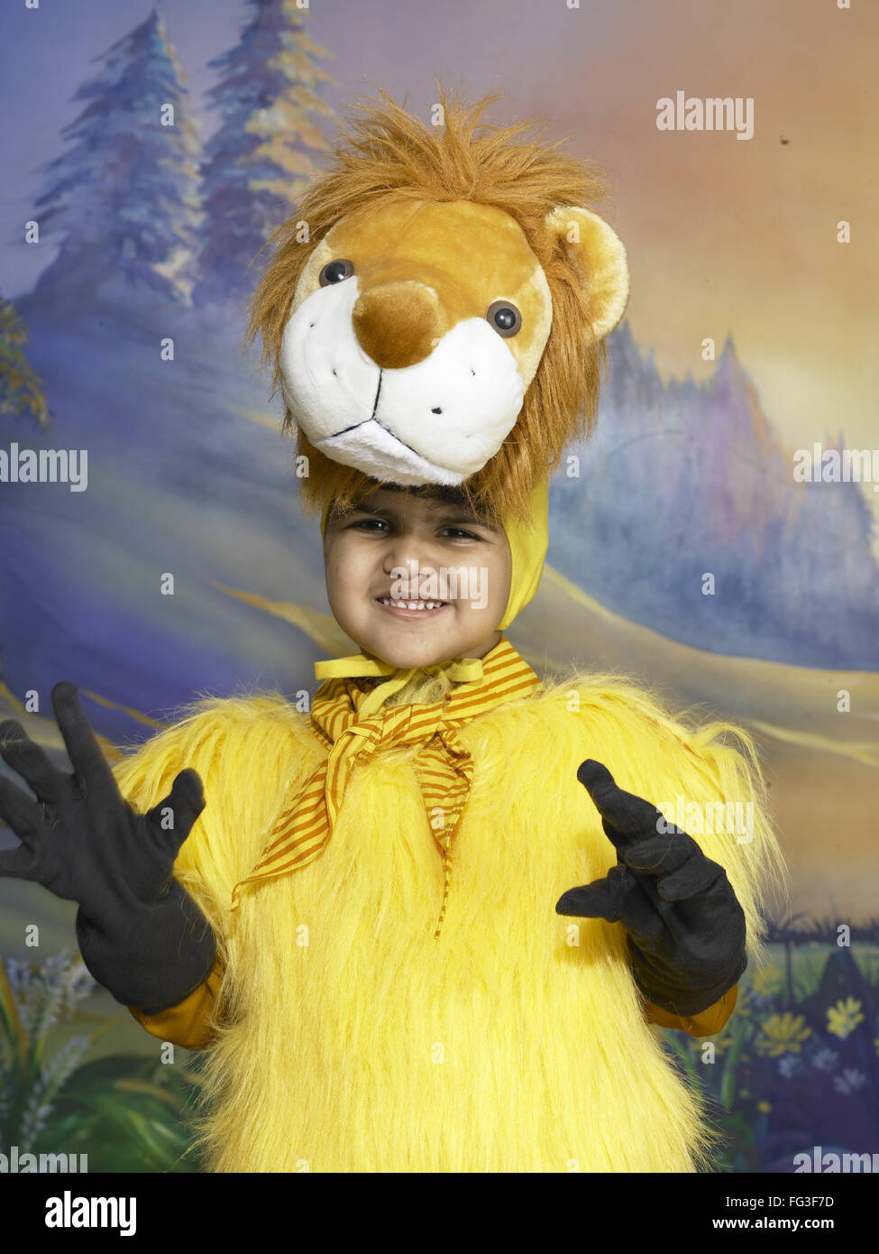 c3cc7ed1b South Asian Indian boy dressed as lion performing fancy dress competition  on stage in nursery school MR