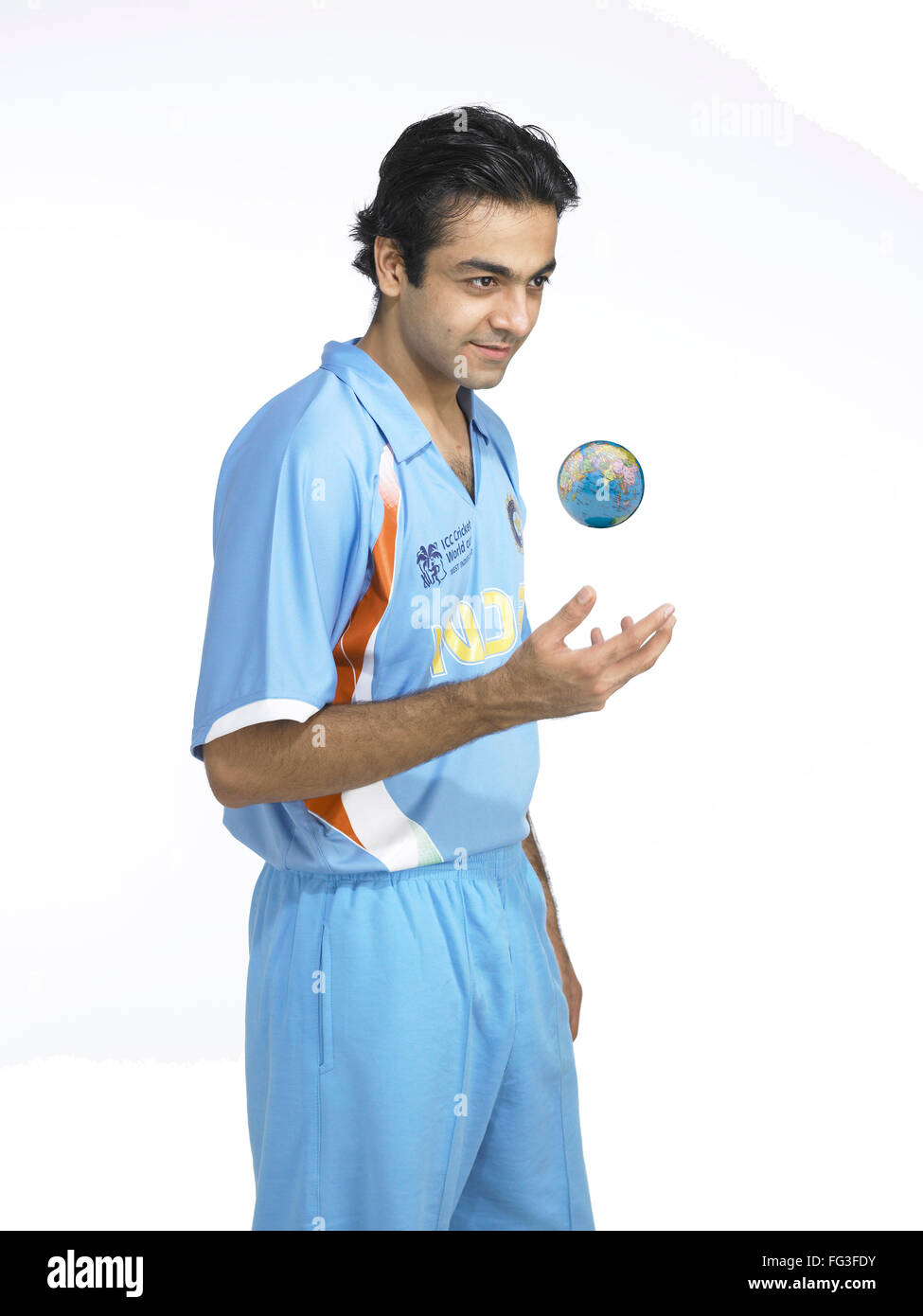 Indian bowler juggling with globe MR#702A - Stock Image