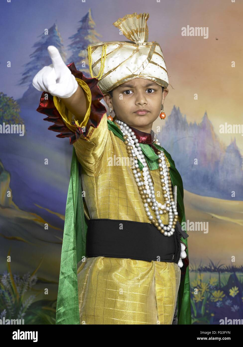 c797d4a6c South Asian Indian boy dressed as prince performing fancy dress competition  on stage in nursery school MR