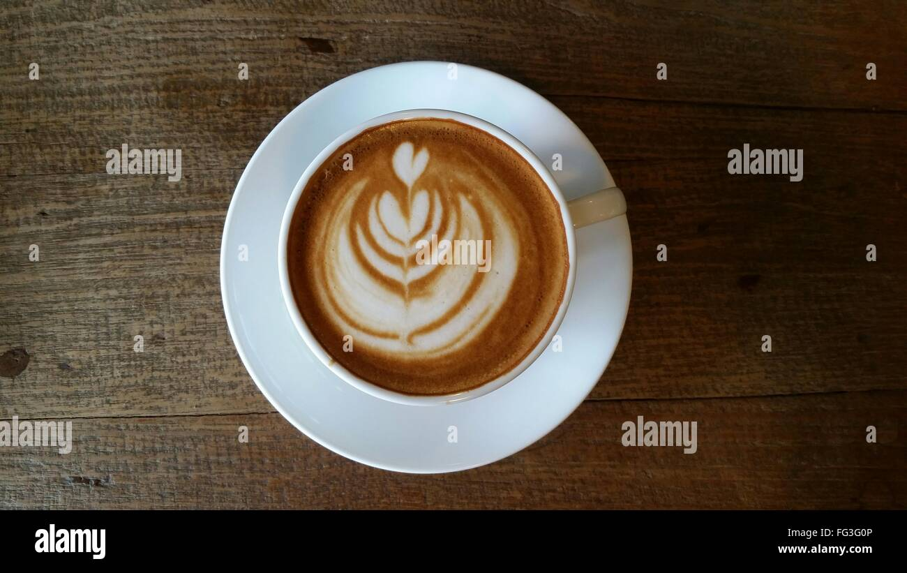 Directly Above View Of Coffee With Latte Art On Table - Stock Image