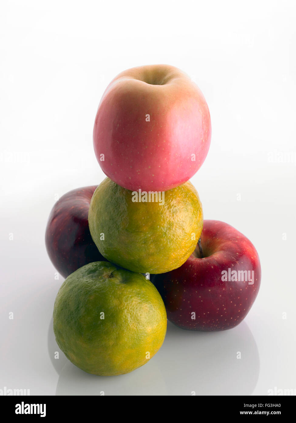 Fruits ; apples and oranges arrange on white background - Stock Image