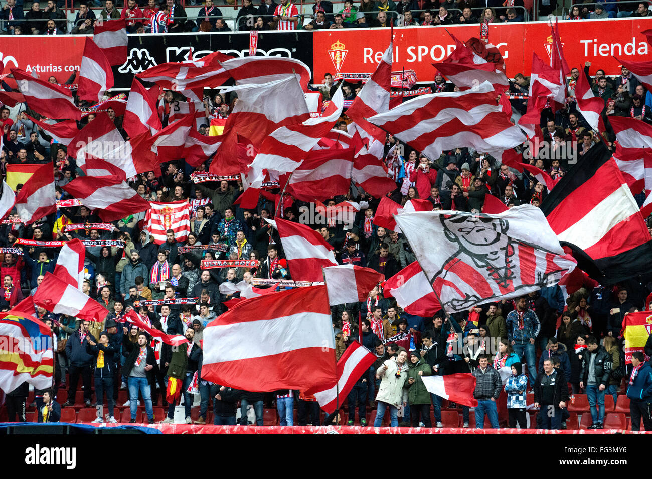 Gijon, Spain. 17th February, 2016. Real Sporting de Gijon's supporters with flags during football match of Spanish - Stock Image