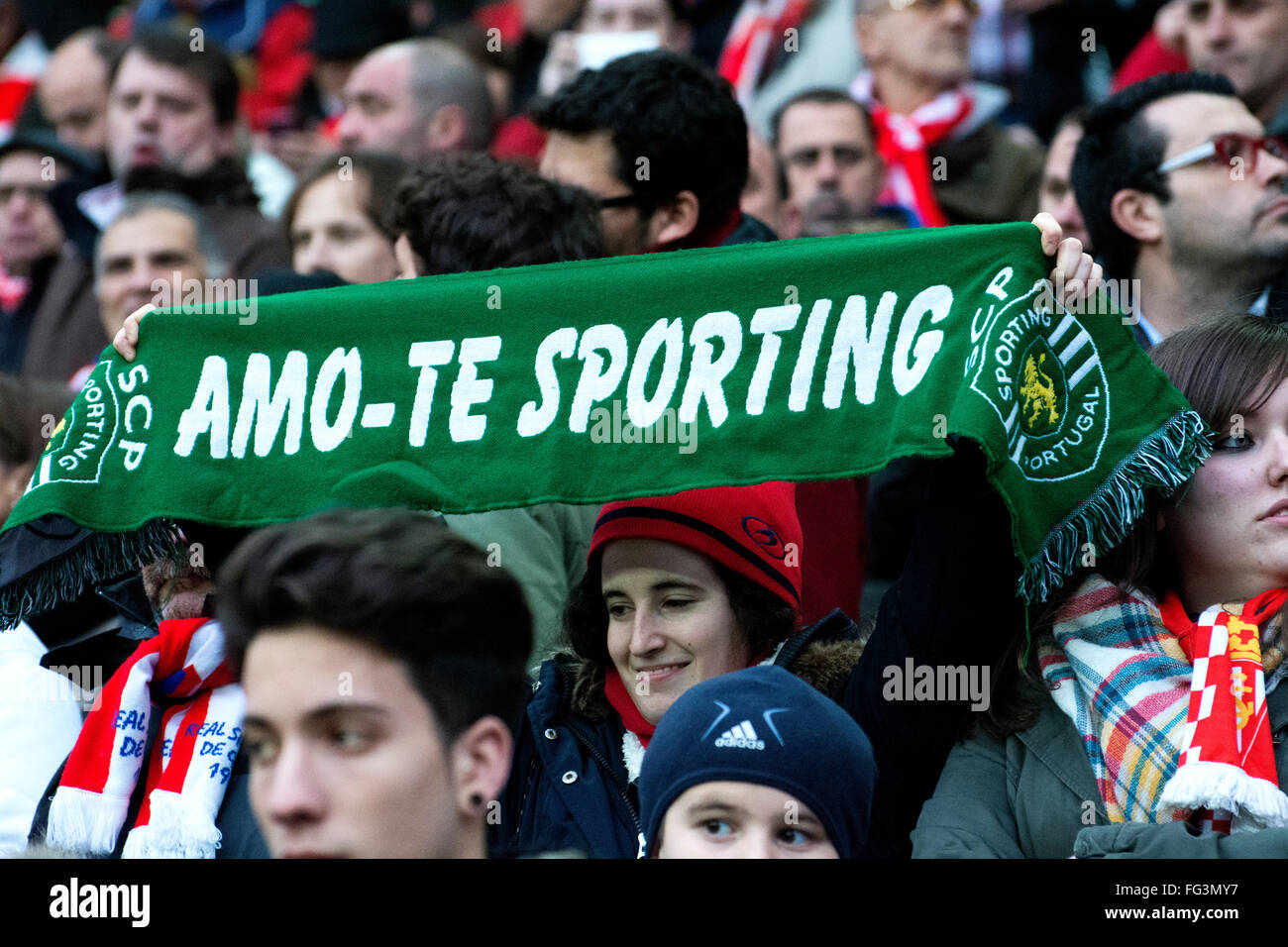 Gijon, Spain. 17th February, 2016. A supporter with the scarf of 'Sporting Club Portugal' during football - Stock Image