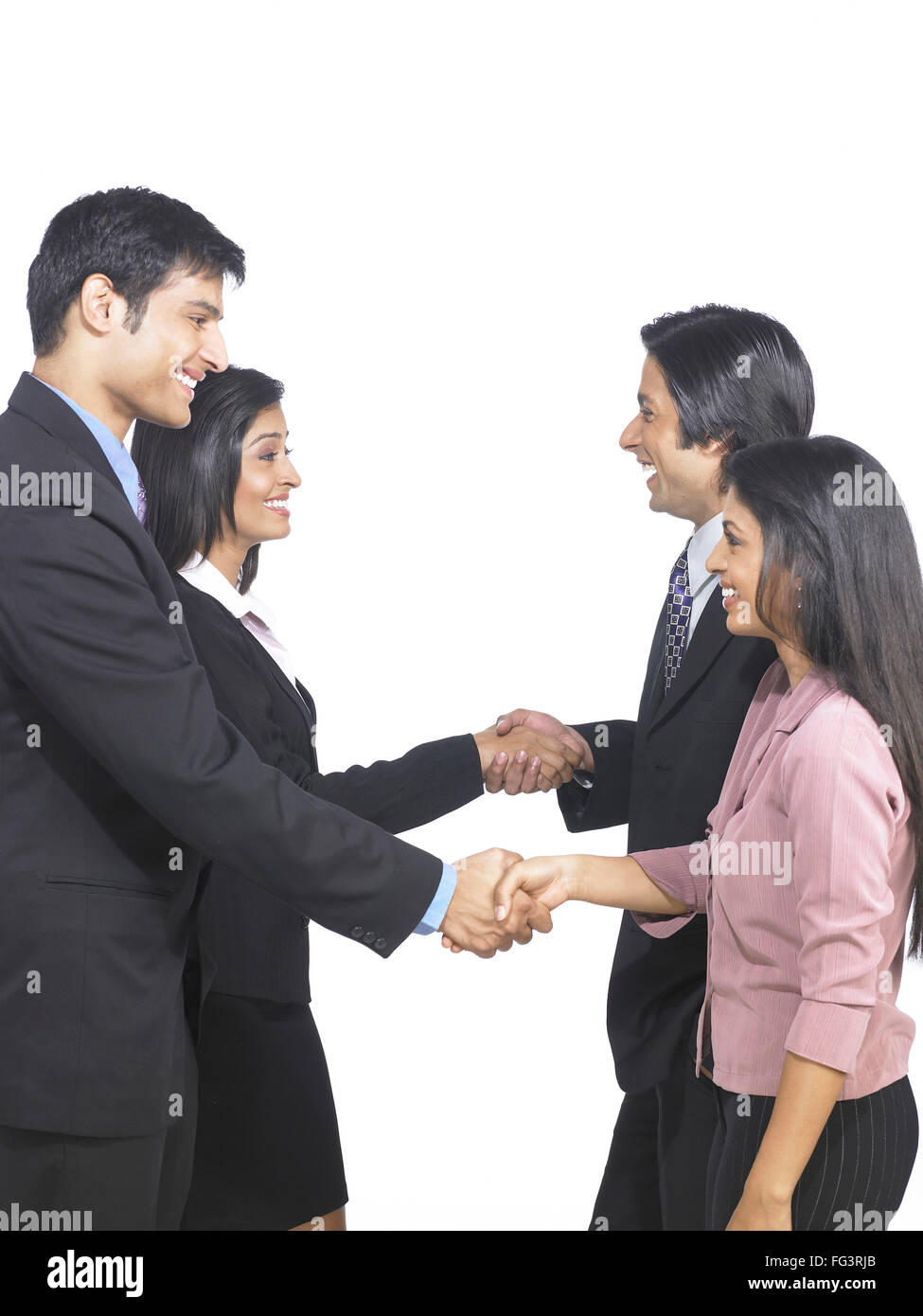 South Asian Indian executive men and women shaking hand MR - Stock Image