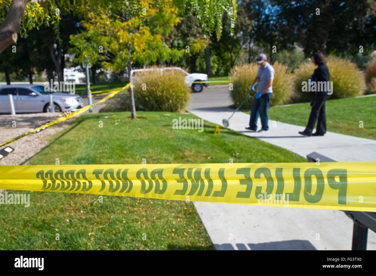 Police caution tape at the scene of a crime in Boise, Idaho, USA. - Stock Image