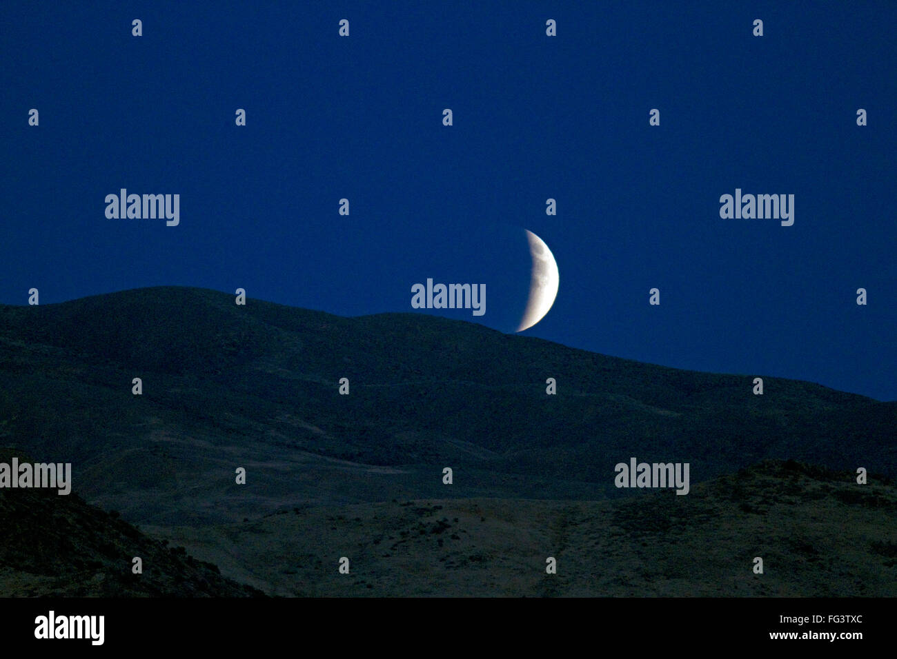 Lunar eclipse rising in the night sky above Boise, Idaho, USA. Stock Photo