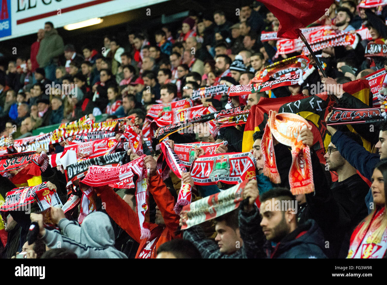 Gijon, Spain. 17th February, 2016. Real Sporting de Gijon's supporters with scarves during football match of - Stock Image