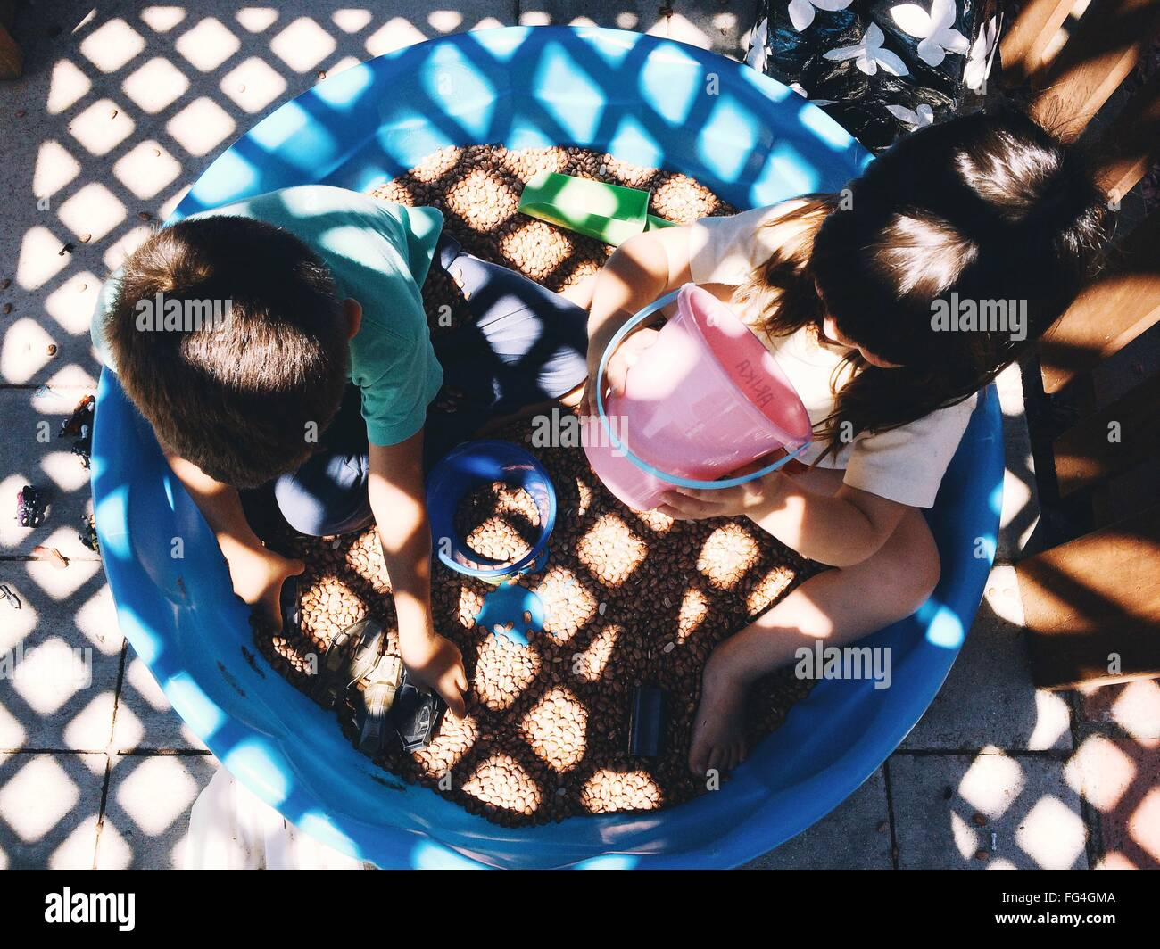 High Angle View Of Siblings Playing In Tub - Stock Image