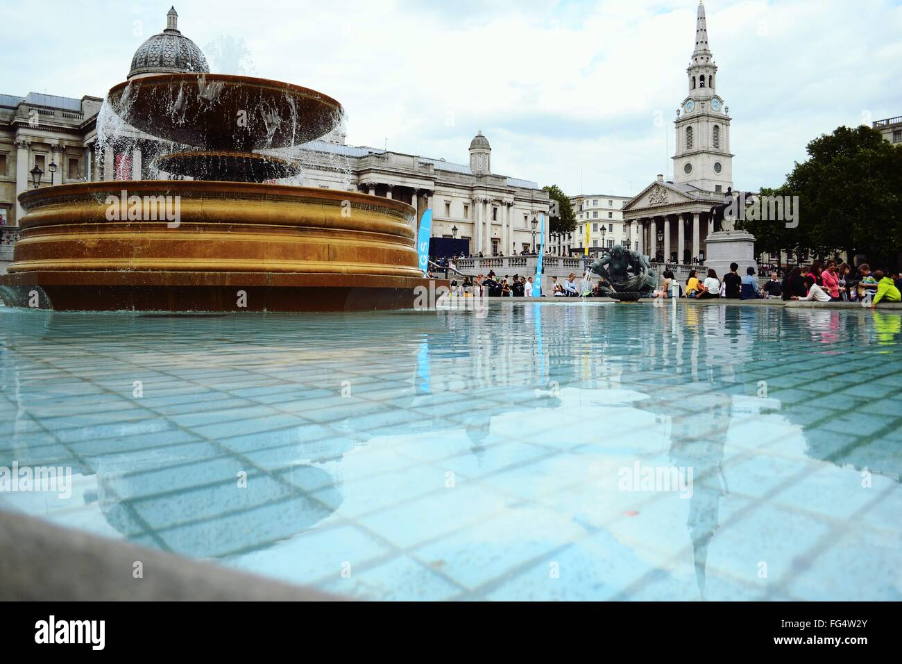 Fountain By People At Leicester Square - Stock Image