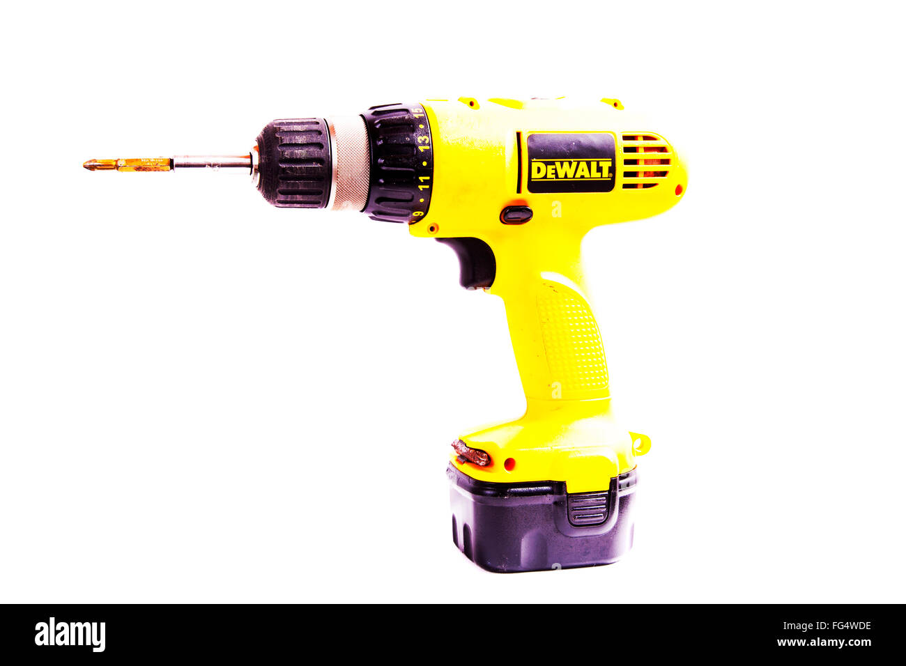 DeWalt de walt drill cordless tool battery operated rechargeable hand tool Cut out cutout product brand isolated - Stock Image
