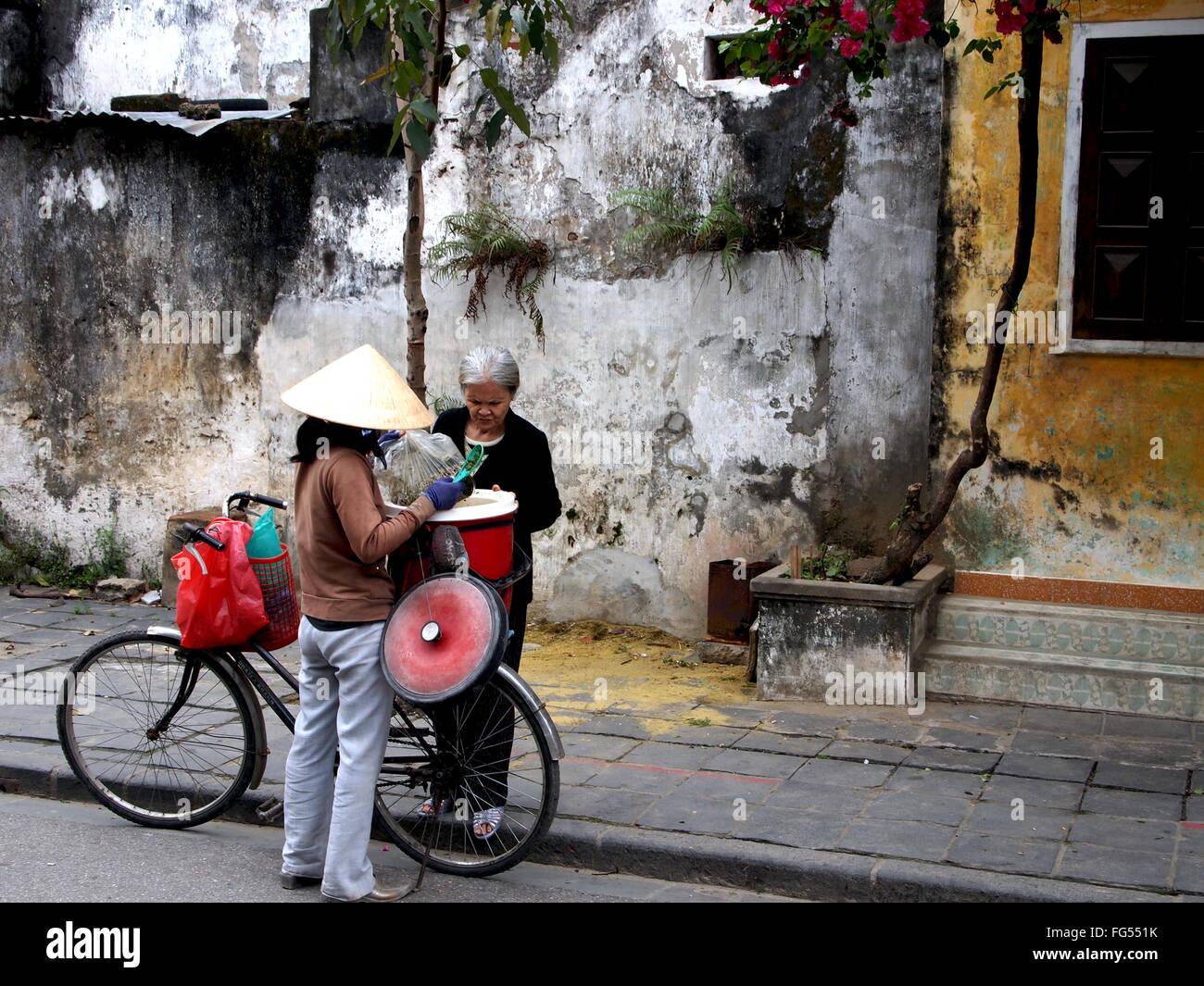 buying street food in Vietnam - Stock Image