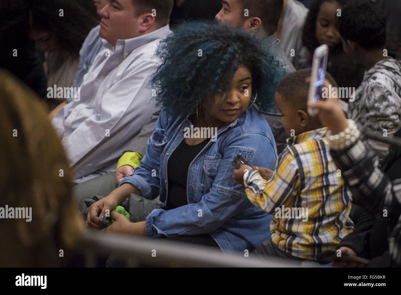 Minneapolis, Minnesota, USA. 13th Feb, 2016. A woman and a child in the audience at a Bernie Sanders campaign event. Senator Bernie Sanders of Vermont, who is seeking the Democratic Party nomination for president, attended the Black America Forum, sponsored by MN Neighborhoods Organizing for Change at Patrick Henry High School in the largely African-American neighborhood of North Minneapolis, Minnesota on Friday, February 12, 2016. After beating Hillary Clinton in the New Hampshire primary earlier in the week, Sen. Sanders began campaigning in earnest for minority voters, who will b Stock Photo