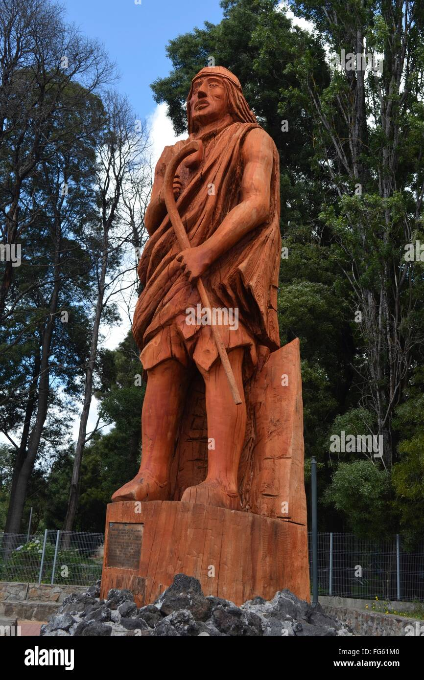 Wooden statue depicting the Mapuche indigenous people of Southern Chile. Villarica, Araucania, Chile. - Stock Image