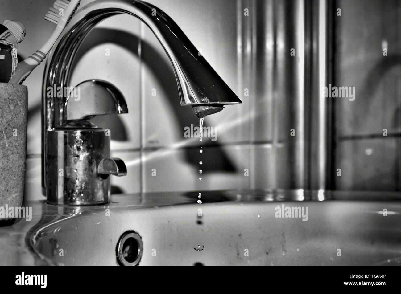 Close-Up Of Water Spilling From Faucet In Bathroom Stock Photo ...