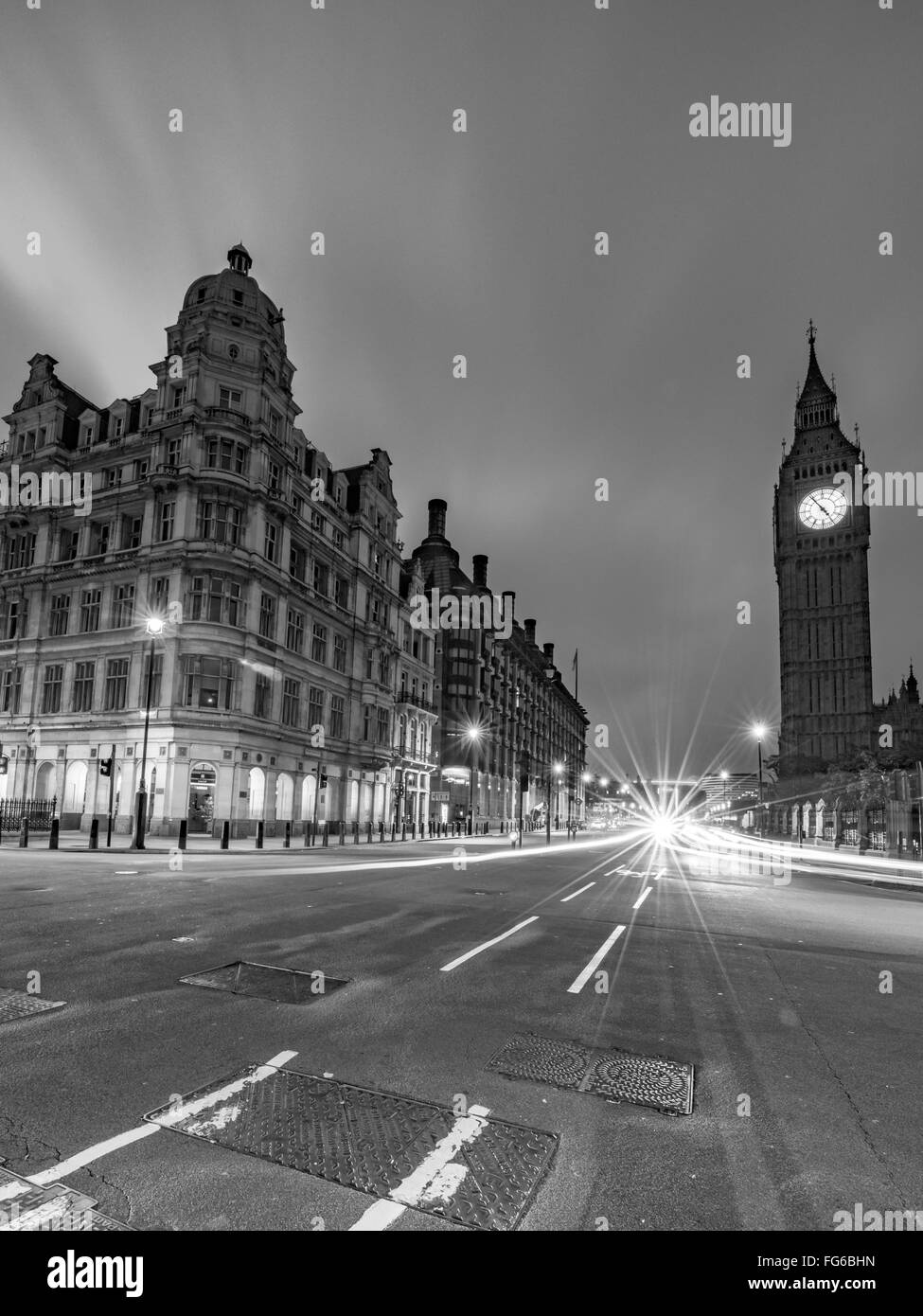 Light Trails On Street Against Big Ben At Night - Stock Image