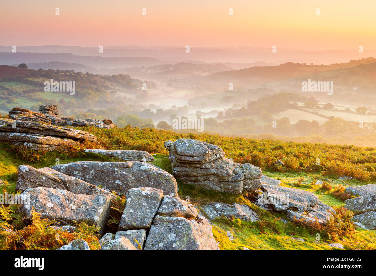 Mist over Bovey Valley seen from Hound Tor, Dartmoor National Park, Manaton, Devon, England, United Kingdom, Europe. - Stock Image