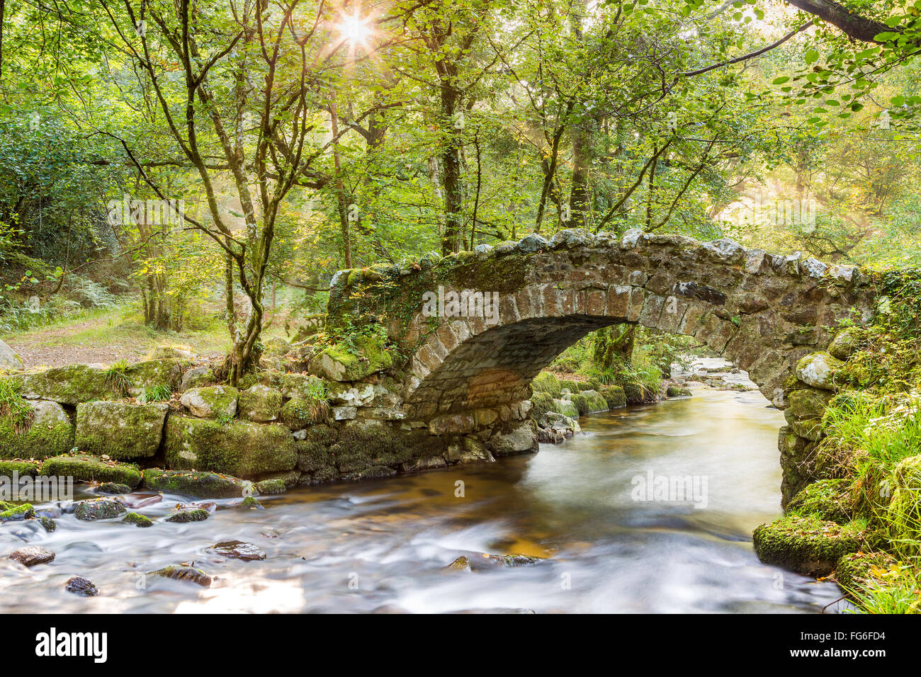 Hisley Bridge crossing the River Bovey, Dartmoor National Park, Lustleigh, Devon, England, United Kingdom, Europe. - Stock Image