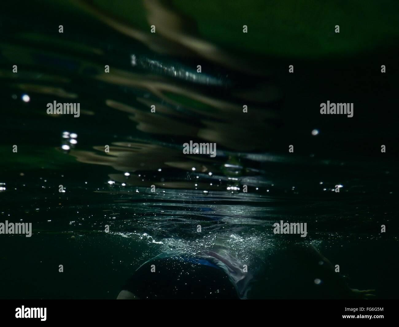 Person Swimming Underwater - Stock Image