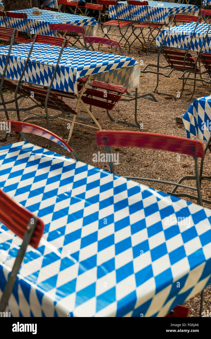 Beer garden, empty tables with white-blue tablecloth, Upper Bavaria, Bavaria, Germany - Stock Image