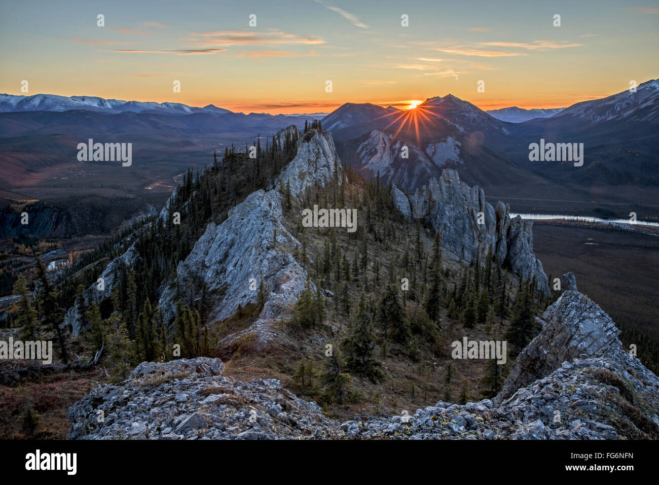 Sunset as seen from the top of Sapper Hill along the Dempster Highway, northern Yukon; Yukon, Canada - Stock Image