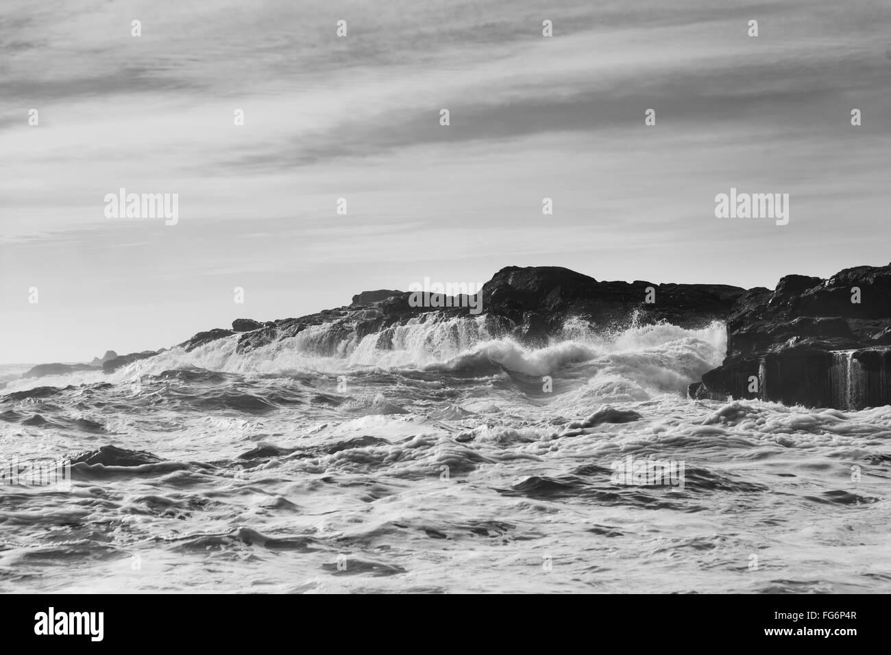 Waves splashing against rocks; Tofino, British Columbia, Canada Stock Photo