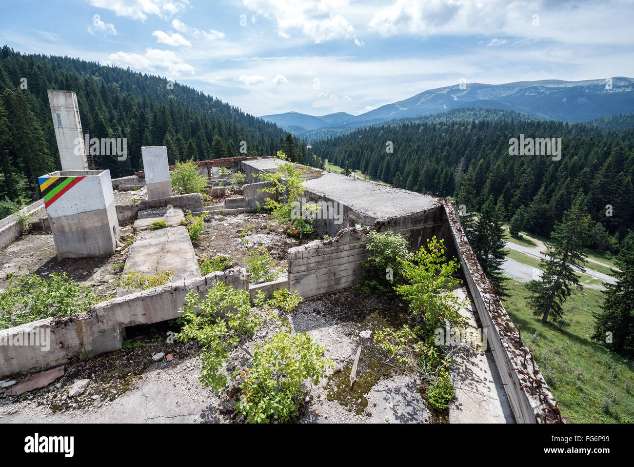 Hotel building damaged during Siege of Sarajevo near Igman Olympic Jumps in Bosnia and Herzegovina - Stock Image