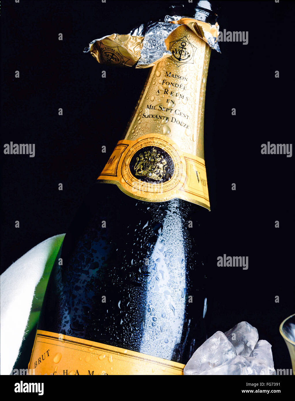 Open bottle of Veuve Clicquot champagne in ice-bucket, London, England, United Kingdom - Stock Image