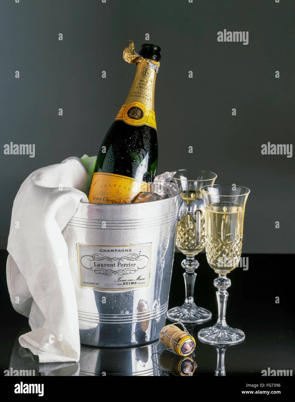 Veuve Clicquot champagne in ice-bucket with napkin and crystal glasses, London, England, United Kingdom - Stock Image