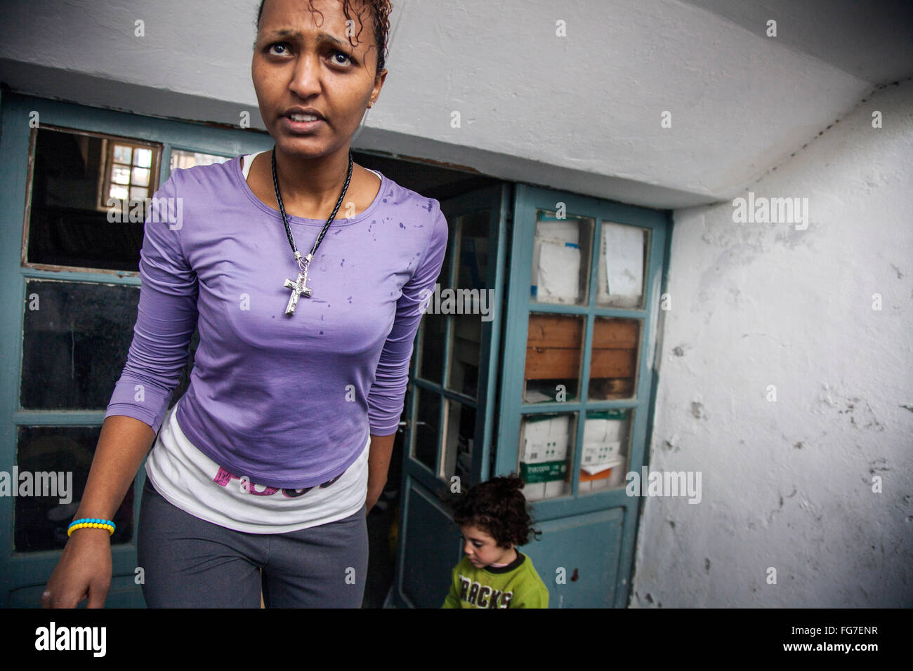 Woman from Sudan waits in the courtyard of Rhodos island police station after the floating boat  38 refugees sank - Stock Image