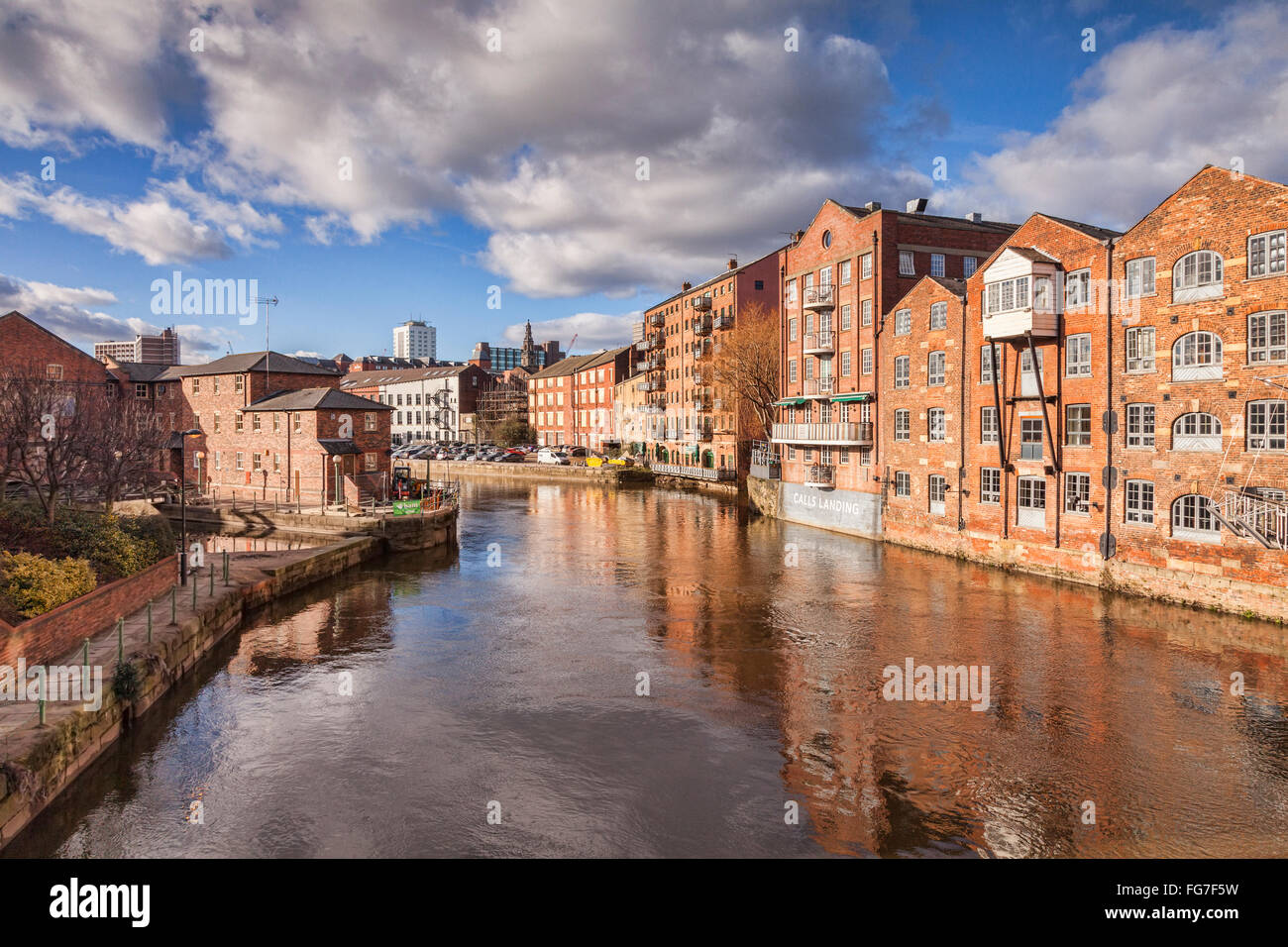 The River Aire in the centre of Leeds, West Yorkshire, England, UK, with apartment buildings on either side, some - Stock Image
