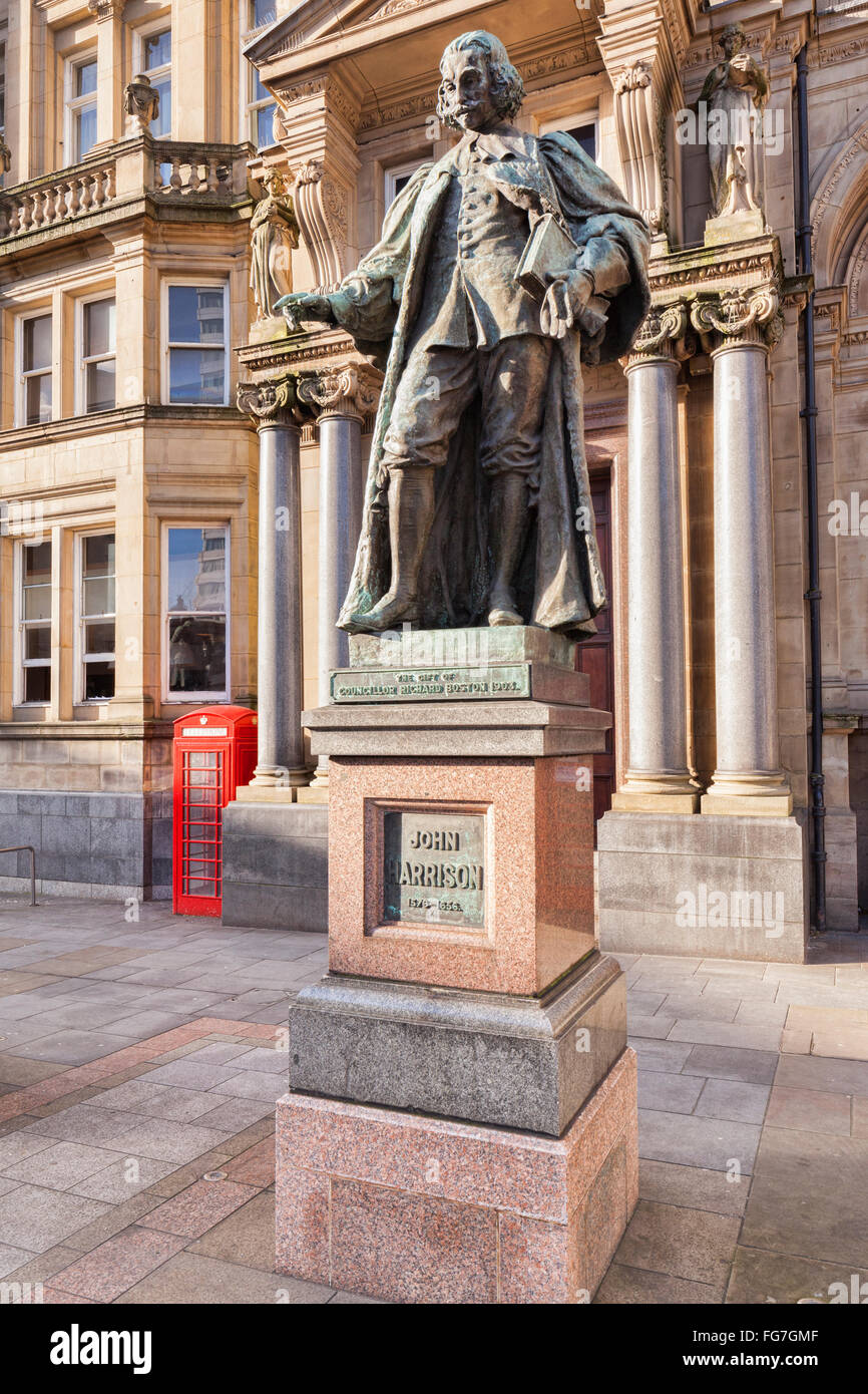 Statue of John Harrison in front of the Old Post Office in City Square, Leeds, West Yorkshire. - Stock Image