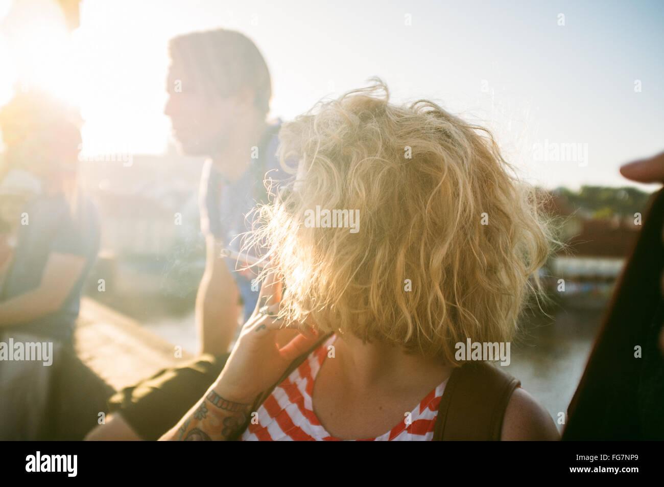 High Angle View Of Woman Smoking Cigarette On Sunny Day - Stock Image