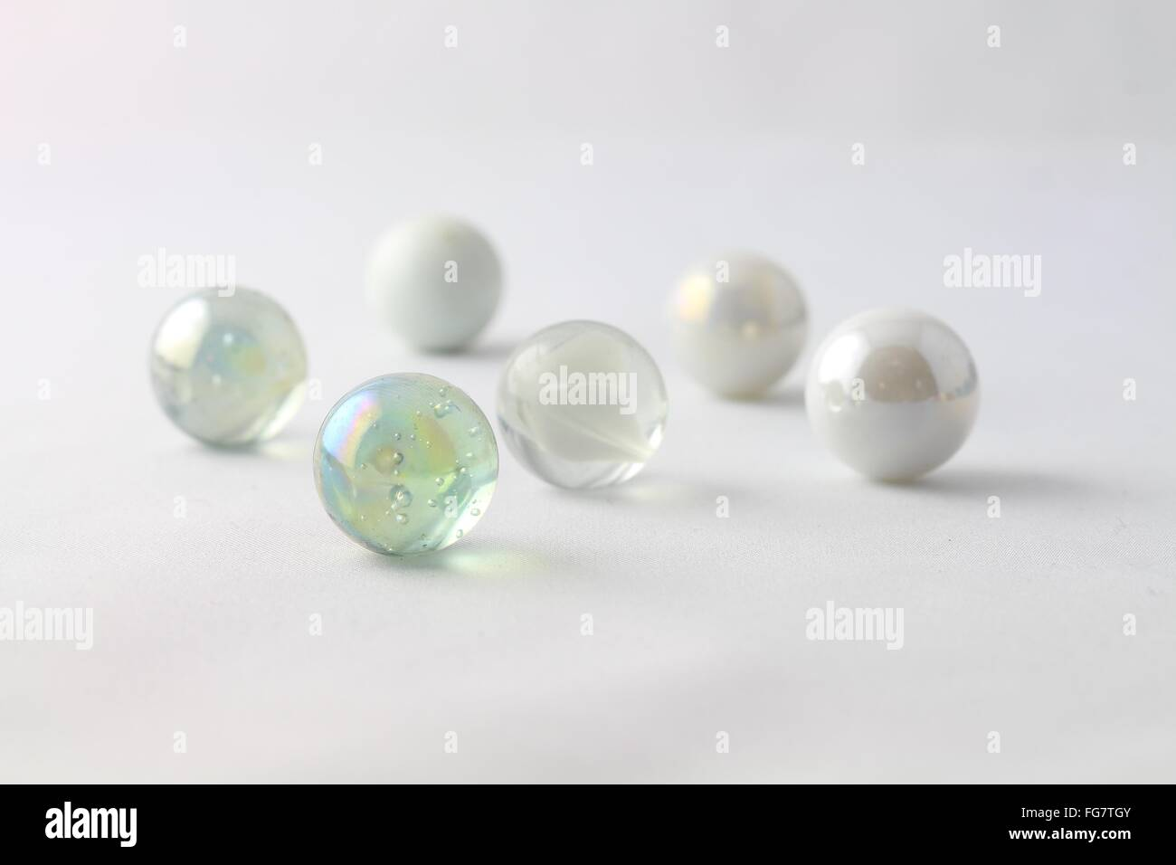 Close-Up Of Marbles Against White Background - Stock Image